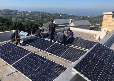 Solar power installation men at work